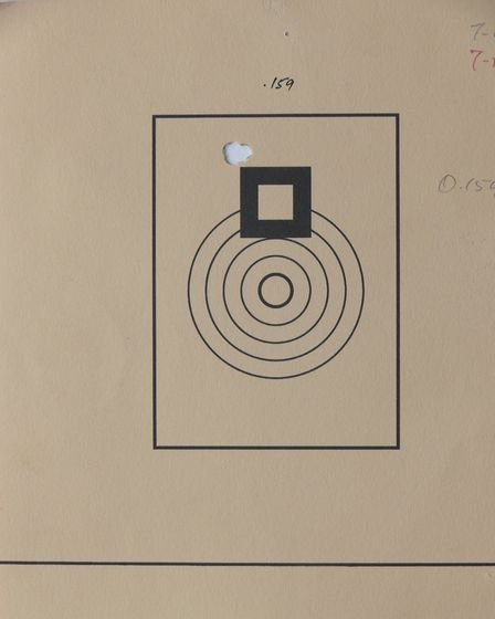 There are five shots in this singular hole shot with a 6mm PPC benchrest rifle, this is what happens
