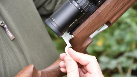 This tiny sidelever operates the single-shot action.