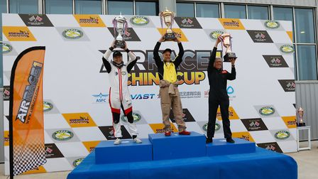 Air Race 1 China Cup silver final: From left second place getter Stan Damiron, winner Steve Tumlin a
