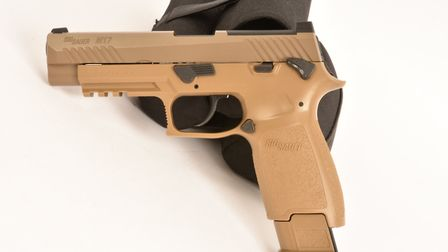 Note the extended magazine that holds the lever's pivot