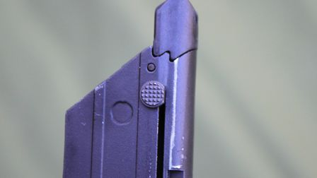 You have to pull down this button in order to load the magazine.