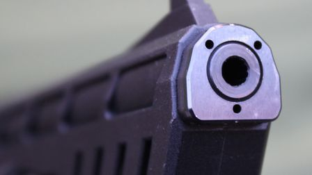 The steel barrel liner has a steel plate at the muzzle for the moderator to index upon.