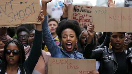 TOPSHOT - Demonstrators from the Black Lives Matter movement march through central London on July 10