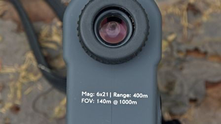 The viewfinder features an adjustable focus ring.