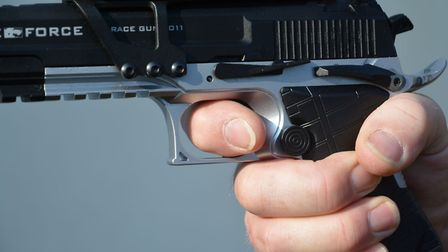Dont pull the trigger like this. Only the pad of the finger should be in contact.