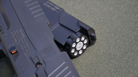 An 8-shot magazine is neatly concealed
