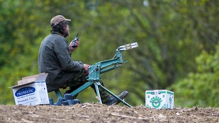 Man operating the clay trap at a simulated game shooting