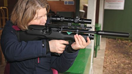 Mandy's an experienced shooter and, like me, she'd prefer that fore end to remain uncluttered. (INS