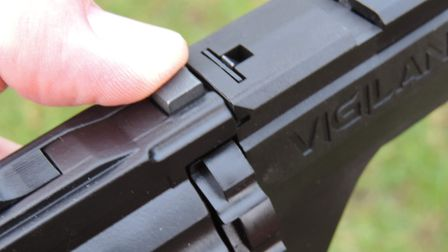 Press down on the release latch to break the action like a traditional Webley revolver.