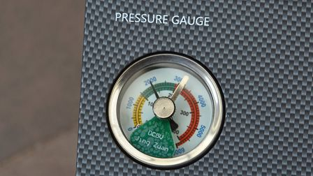 Set the silver dial to the required pressure and watch the black needle climb.