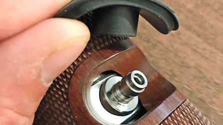 The fill port is hidden underneath this rubber cap