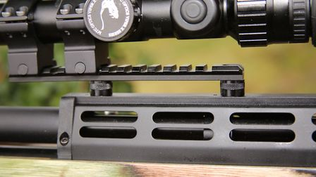 The scope rail sits on a pair of pillars.
