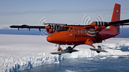 Twin Otter VP-FAZ with MASIN turbulence probe fitted overhead the Fuchs Ice Piedmont of Adelaide Isl
