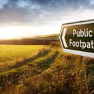 Public footpath, just before sunset showing public right of way across fields in the English country