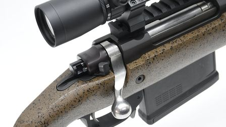Three position safety enables a fully locked bolt and firing pin