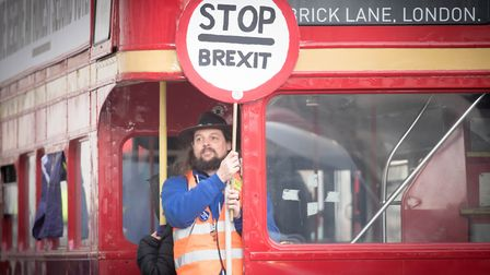 A man holds a 'Stop Brexit' sign aboard a campaign bus travelling down Whitehall. Photograph: Stefan
