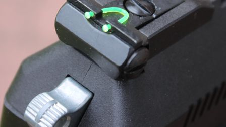 The green fibre-optic 'U' on the rear sight certainly works.