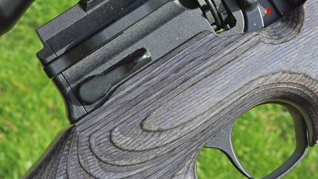 Action area. Sidelever, trigger, safety and mag' release lever. For me, the latter is on the wrong s