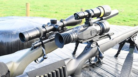 Both show three position safety catches with bolt locking capability. The larger lever on the Sauer