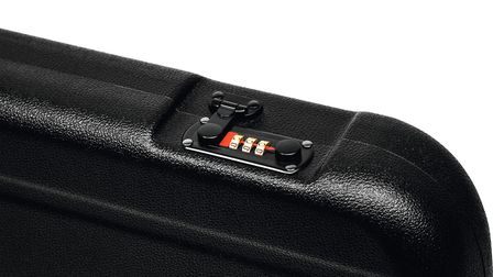 Black plastic hard case for transporting and storing weapons. Gun container isolate on a white backg