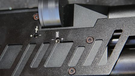 Note the trigger adjustment ports just below the magazine slot. Easy tweaking for all.