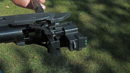 The windage adjustment for the rear sights is housed in the block