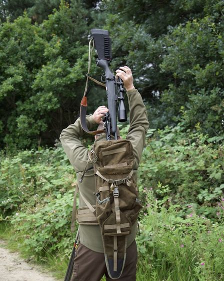 Moderator and Bipod push the dimensions a little but still fit - if perhaps a little more securely