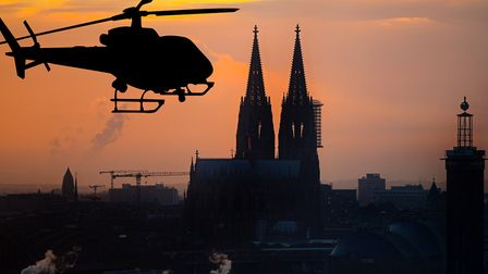 European Rotors : Helicopter in front of Cologne Cathedral,