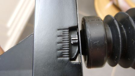 This shows the adjustment dial on the side