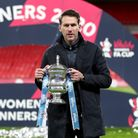 Manchester City manager Gareth Taylor poses with the trophy after the Women's FA Cup Final at Wemble