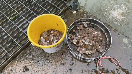 Members of Cheddar Lions and Bristol Water emptied the Wishing Pool. Picture: Cheddar Lions