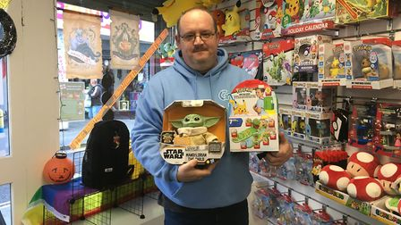 John with some of this year's most-wanted Christmas toys.