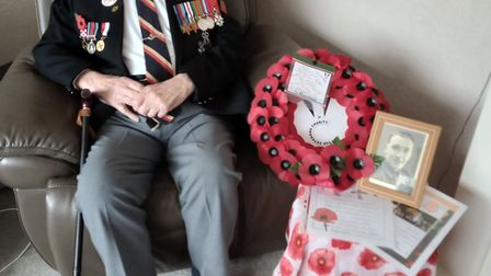 Reg Charles, 97, World War 2 and Normandy Veteran, with wreath that travelled to London.