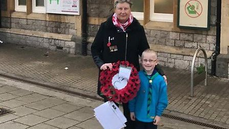 Sheila and Oliver about to deliver the poppy wreath to Weston train station
