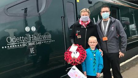 Sheila Harding with her son David and grandson Oliver outside the GWR train that was London bound.