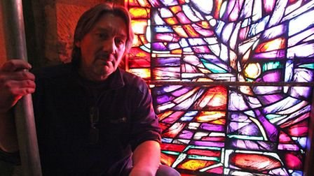 Alan Davis pictured next to his newly installed Tyrrell window. A £60,000 legacy from the Wills of f