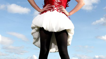 Charlotte wears a red and white dress in pleated georgette with triple layered skirt and multiple la