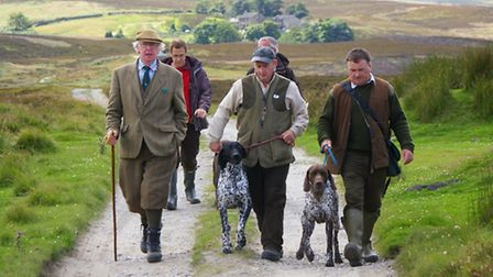 123 Paul Osbaliston walks with handlers, with Harbour lodge in the background