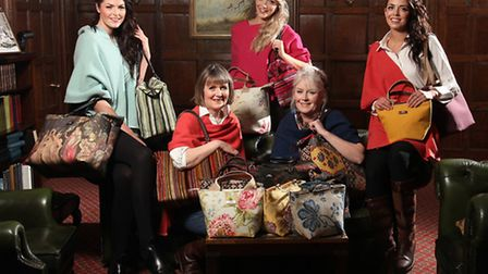 Two of the founders of North Yorkshire based Umpie Bags, seated from left, Alison Booth and cousin J