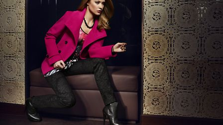 Raspberry pink jacket by Tuzzi teamed with black skinny jeans and multi-coloured top, splashes of vi