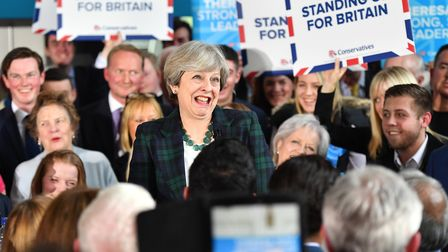 LEEDS, ENGLAND - APRIL 27: Britain's Prime Minister Theresa May speaks to supporters at a campaign