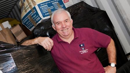 Award-winning teacher Barry Brindley loads a container for Malawi
