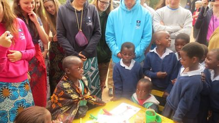 School children read to visitors including GSAL student Kate Downie (second left)