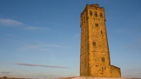 A winter view of Victoria Tower, on Castle Hill, which over looks Huddersfield, West Yorkshire. © Ma