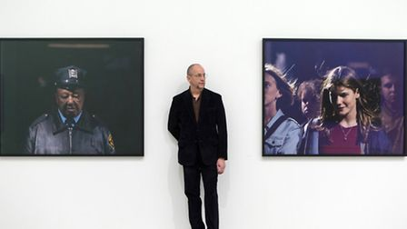 Artist Philip-Lorca diCorcia with part of his Heads (2000-01) series. Photo: Bob Collier