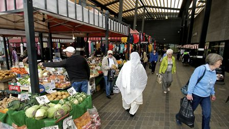 Customers shopping in Wakefield market hall
