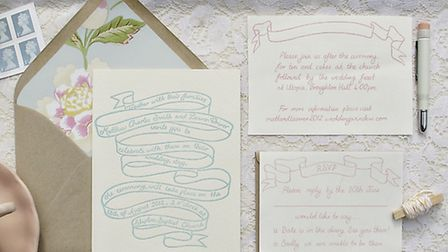 This simple design is complemented with a beautiful floral envelope