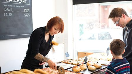 Violet serves customers in the bakery shop