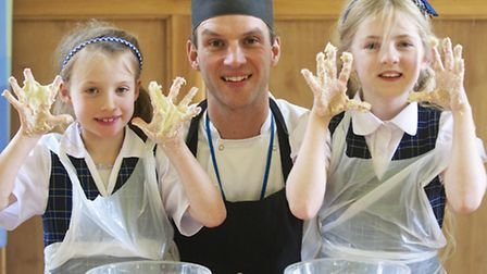 Pupils from years 3 and 4 Mount School , York enjoy a real bread making session with James Goodwin