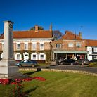 Easingwold is a pretty village with its landmark clock tower, neat market square and war memorial Ph
